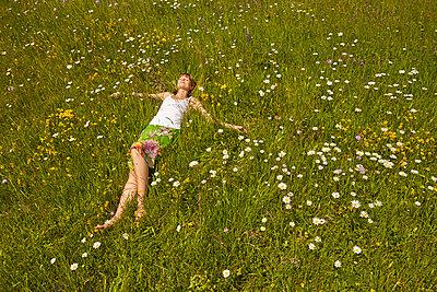 Woman on flower meadow - p888m955450 by Johannes Caspersen