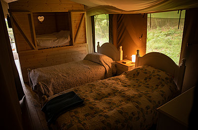 Beds with quilts in yurt cabin - p1023m2261480 by Sam Edwards