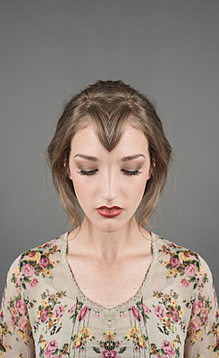 Symmetrical, constructed portrait of young woman looking down. From art project Symmetry. - p1433m2151378 by Wolf Kettler