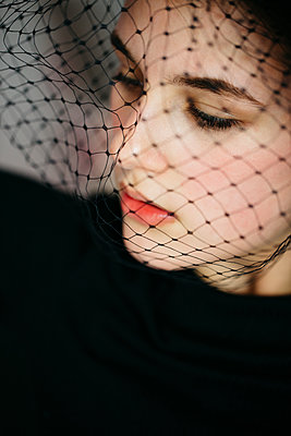 Young girl with a black veil - p1621m2260400 by Anke Doerschlen