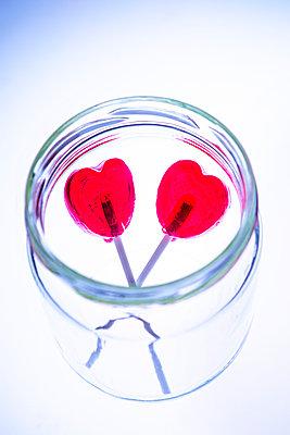 Two heartshaped lollipops in jar - p1149m2192765 by Yvonne Röder