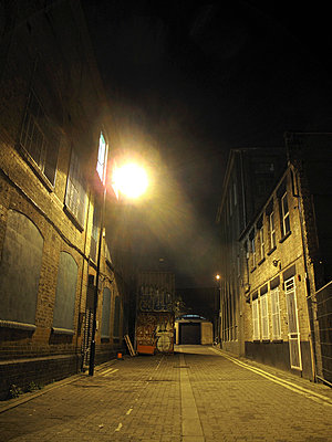 Illuminated alleyway in East London - p1072m829285 by Neville Mountford-Hoare