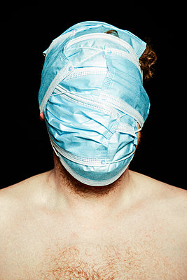 A man's face covered with surgical masks - p930m2253764 by Ignatio Bravo