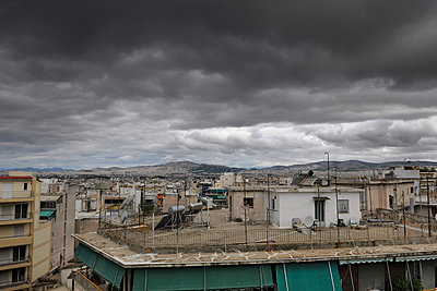 Athens rooftop shack - p1048m1040897 by  Mark Wagner