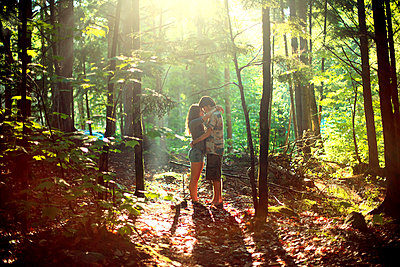 Couple hugging in sunny forest - p555m1408957 by Shestock