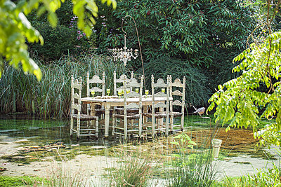 Ornate dining table floating in pond - p675m922835 by Odilon Dimier