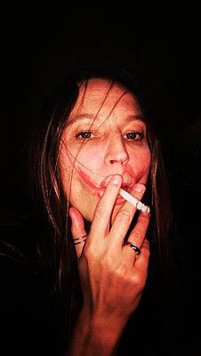 Female smoker - p551m1586313 by Kai Peters