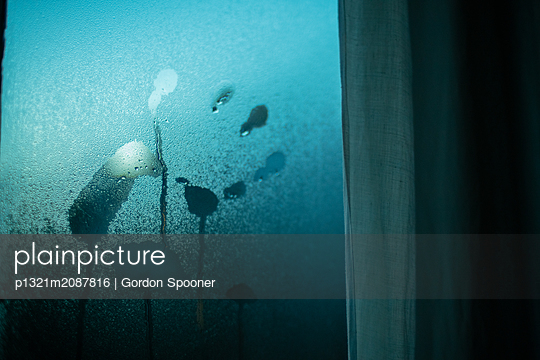 Handprint on windowpane - p1321m2087816 by Gordon Spooner