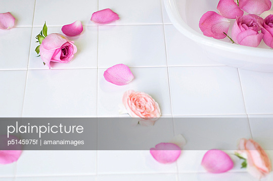 Rose petals floating in a washtub