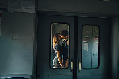 Couple kissing on train - p1427m2202240 by Kateryna Soroka