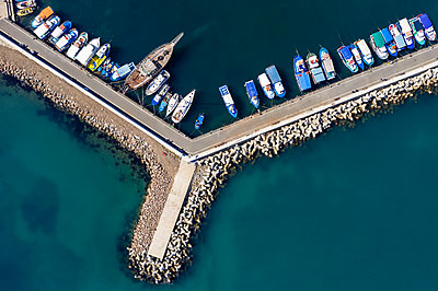 Aerial view to a boats in the port - p1596m2204672 by Nikola Spasov