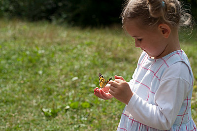 Little girl with butterfly - p7630014 by co-o-peration