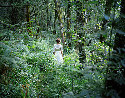 Woman in forest - p945m831196 by aurelia frey