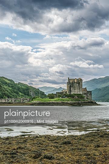 Eilean Donan, a remote Scottish castle on a tidal island, with bridge. - p1100m2300916 by Mint Images