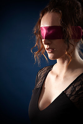 Woman With Red Blindfold - p1248m2063471 by miguel sobreira