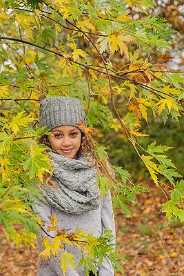 Portrait of a girl in a park, Autumn - p1323m1190229 by Sarah Toure