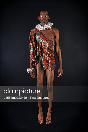 Contemporary African man in modern traditional garments  - p1554m2223499 by Tina Gutierrez