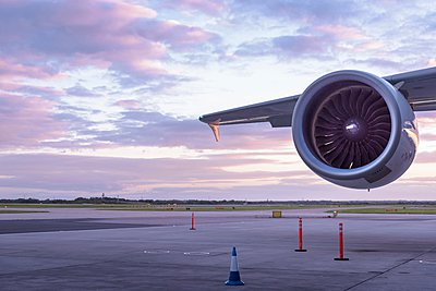 Detail of jet engine of A380 aircraft at sunset - p429m1095259f by Monty Rakusen