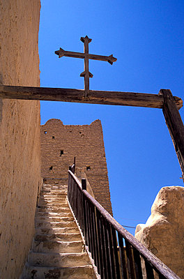 Low angle view of stairs and a cross at St Paul's Monastery - p6441526 by Chris Bradley