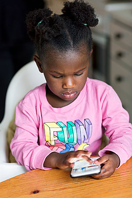 Girl using cell phone - p312m1556838 by Susanne Kronholm