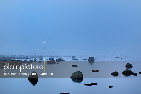 Lange Jan Lighthouse seen through fog in Oland, Sweden - p352m2120855 by Eddie Granlund