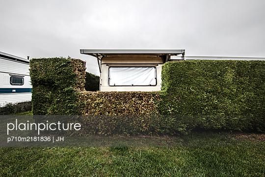 Static caravan behind hedge - p710m2181836 by JH