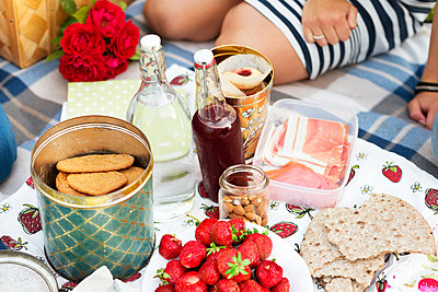 Food on picnic blanket - p312m1121655f by Rebecca Wallin