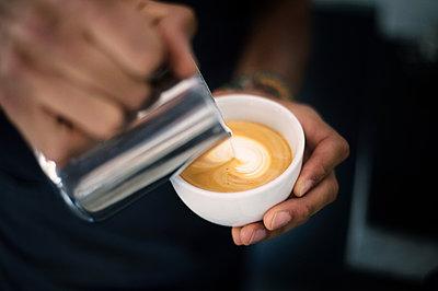 Hand of barista making coffee latte - p947m2176900 by Cristopher Civitillo