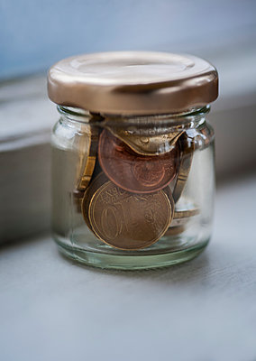 Coins in a jar - p971m900279 by Reilika Landen