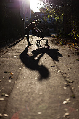 Woman with stroller - p795m2020885 by Janklein