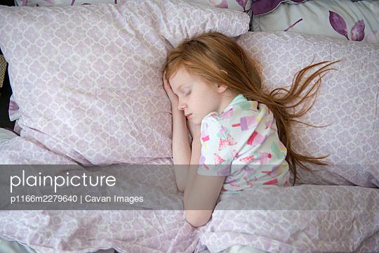 Sick Little Girl in Bed Sleeping - p1166m2279640 by Cavan Images