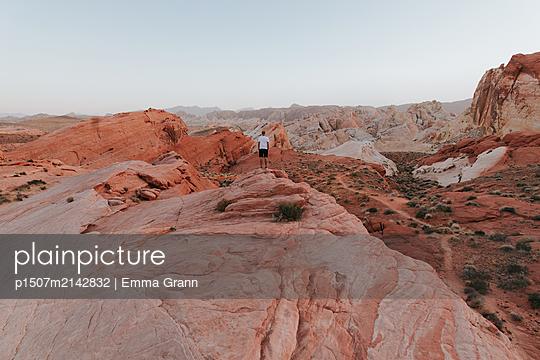 Small man in big landscape - p1507m2142832 by Emma Grann