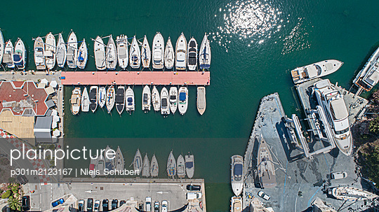 Aerial view from above sunny boats and yachts moored in harbor, Theoule-sur-Mer, Alpes-Maritimes, Fr - p301m2123167 by Niels Schubert