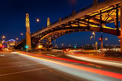 Traffic on street through city at night, long exposure - p429m824423 by Zero Creatives