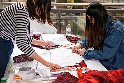 Seamstresses creating garment - p429m1513866 by G. Mazzarini