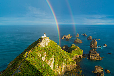 Double rainbow over Nugget Point lighthouse after the storm. Ahuriri Flat, Clutha district, Otago region, South Island, New Zealand. - p651m2032775 by Francesco Vaninetti