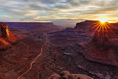 High angle scenic view of rock formations against cloudy sky at Canyonlands National Park during sunrise - p1166m1509625 by Cavan Images