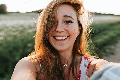 Smiling Self-Portrait  - p1507m2168052 by Emma Grann