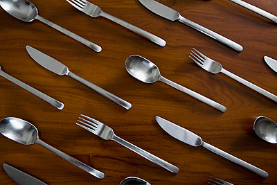 Silverware arranged in a pattern on a table - p30115605f by Epoxydude