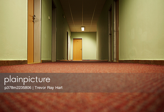 Low angle view of hotel corridor - p378m2235806 by Trevor Ray Hart