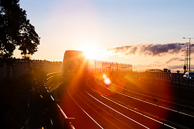 Train at sunset - p312m2092193 by Peter Rutherhagen