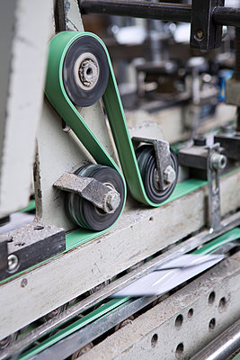 Close up of machine in cardboard factory - p429m942789f by Judith Haeusler
