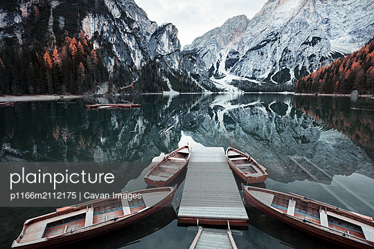 Wooden boats at the alpine mountain lake. Lago di Braies - p1166m2112175 by Cavan Images