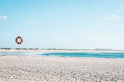 Life-buoy on the beach - p299m2164253 by Silke Heyer