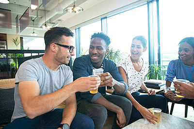 Happy business people celebrating with beers in office - p1023m2262108 by Himalayan Pics