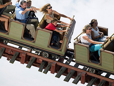 People on a roller coaster - p9249970f by Image Source