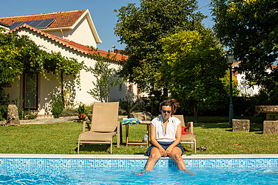 Portugal, Woman at pool - p1291m2230649 by Marcus Bastel