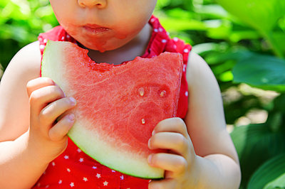 Girl eating watermelon - p1427m2128223 by Jamie Grill