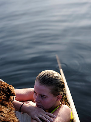Bathing lake, Young woman and dog - p551m2134187 by Kai Peters