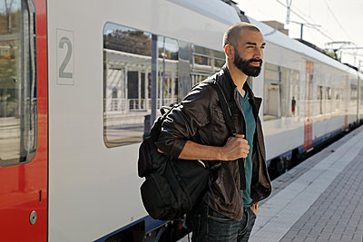 Bearded man in a train station - p1540m2122821 by Marie Tercafs